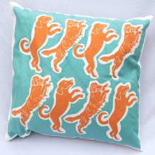 orange and blue dog cushion