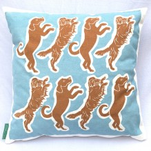 blue and brown dancing dog cushion