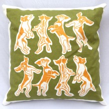 gold and green laughing dogs cushion